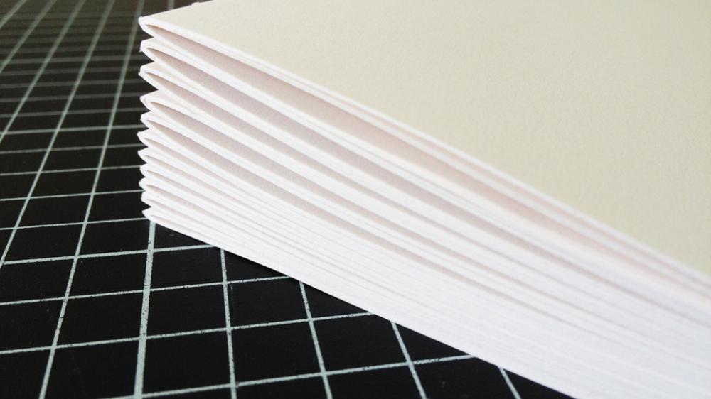 trim cutting the paper